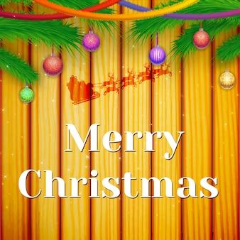 Carte de fête d'hiver avec des branches de sapin vert rubans colorés suspendus boules ornées sur bois