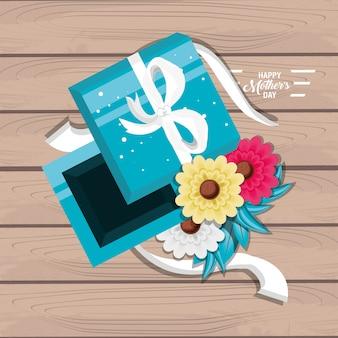Carte de fête des mères avec cadeau et fleurs