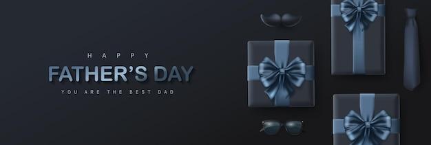 Carte de fête des pères heureuse avec boîte-cadeau sur fond sombre