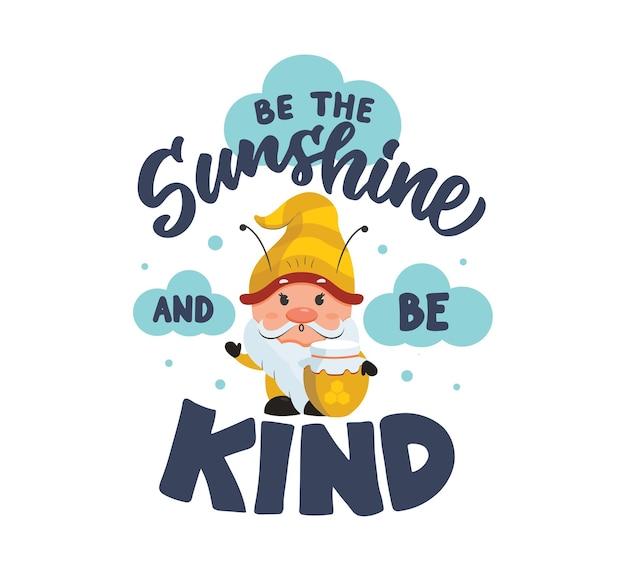 La carte avec gnome et lettrage citation soit le soleil et sois gentil le dessin animé avec du miel