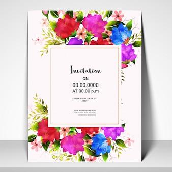Carte d'invitation avec des fleurs colorées d'aquarelle.