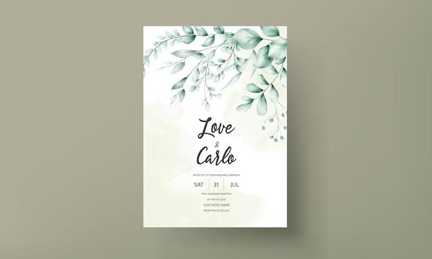Carte d'invitation de mariage avec une belle décoration de feuille