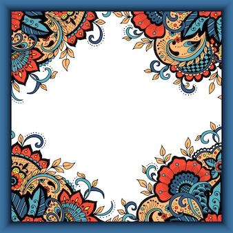 Carte d'invitation de mariage avec des éléments floraux abstraits dans le style indien mehndi.
