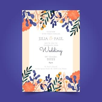 Carte d'invitation de mariage floral avec des fleurs dessinées à la main
