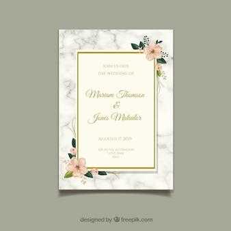 Carte d'invitation de mariage avec des ornements floraux