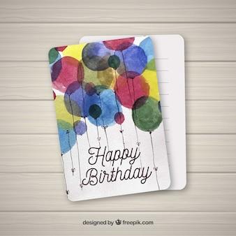 Carte de joyeux anniversaire avec des ballons aquarelles