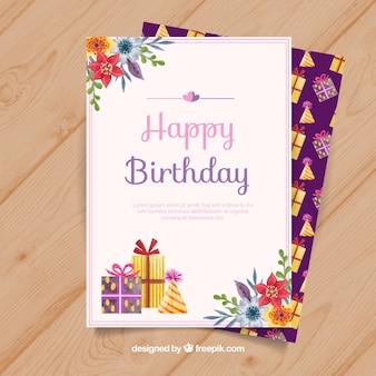 Carte de joyeux anniversaire avec des fleurs et des cadeaux dans un style aquarelle