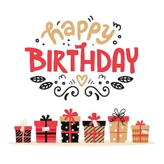 Carte de joyeux anniversaire avec lettrage et cadeaux. conception mignonne pour carte de voeux.