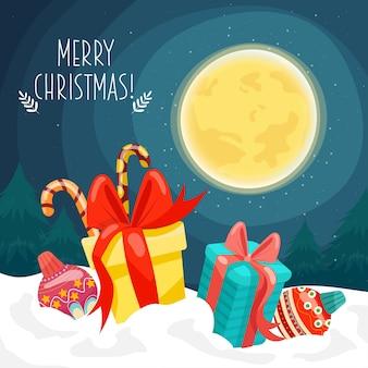 Carte de joyeux noël avec des coffrets cadeaux placés sur la neige et la lune