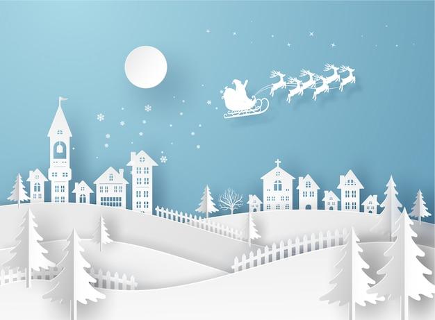 Carte de joyeux noël dans le paysage d'hiver avec des maisons et des bâtiments et le père noël sur le ciel