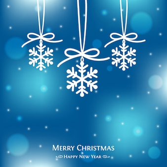Carte de joyeux noël avec des décorations de flocons de neige.