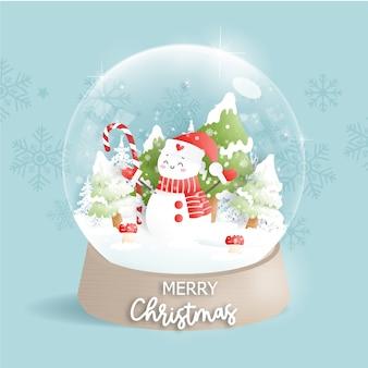 Carte de noël avec boule à neige et bonhomme de neige