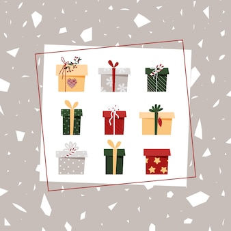 Carte de noël avec coffrets cadeaux sur fond gris. carte postale de nouvel an dans un carré.