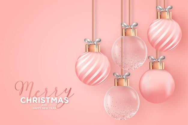 Carte de noël élégante avec des boules de noël roses réalistes