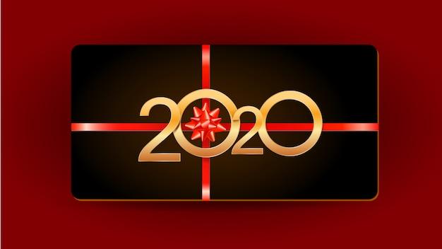 Carte noire de 2020 happy new year avec chiffres dorés, ruban et noeud de cadeau isolé sur le rouge