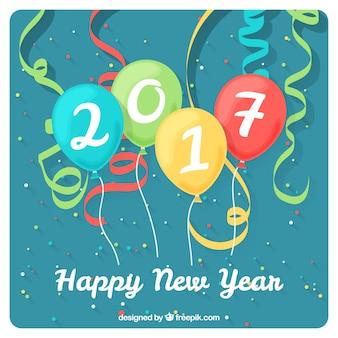 La carte de nouvel an avec des ballons et des banderoles