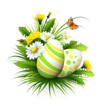 Carte de pâques avec des oeufs et des fleurs.