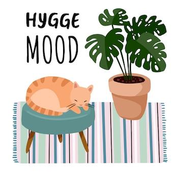Carte postale humeur hygge. chat sur un tabouret à l'intérieur d'une chambre élégante et scandaleuse. décorations maison lagom. saison confortable. appartement moderne et confortable meublé dans un style hygge