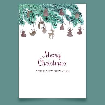 Carte postale de noël avec des branches de conifères et des jouets en bois