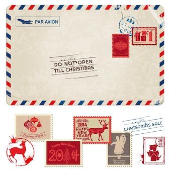 Carte postale vintage de noël avec des timbres-poste