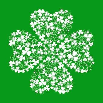 Carte pour la saint-patrick avec un beau trèfle sur fond vert composé de petit trèfle blanc
