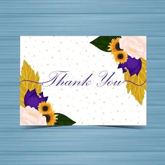Carte de remerciement avec des fleurs et des feuilles d'automne