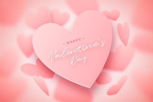 Carte de la saint-valentin avec des coeurs roses tombants et flous, joli fond rose