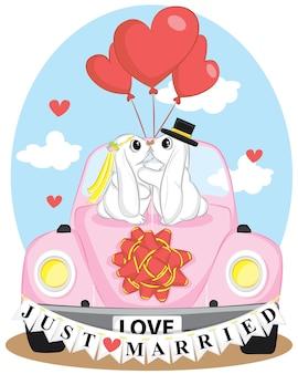 Carte vectorielle avec voiture rétro, couple de lapins mignons, bouquet de fleurs, branches, baies et feuilles et texte écrit à la main « love just married ». modèle d'invitation de mariage vintage.