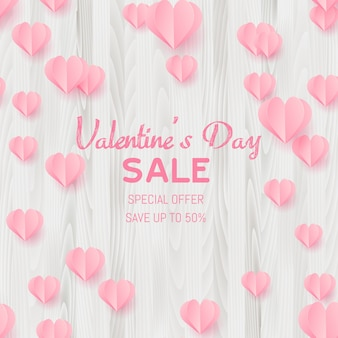 Carte de vente saint valentin avec des coeurs coupés du papier