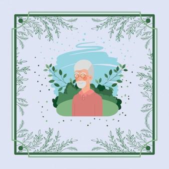 Carte de vieil homme avec cadre à base de plantes
