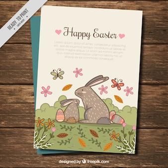 Carte vintage de lapins de pâques dans un paysage