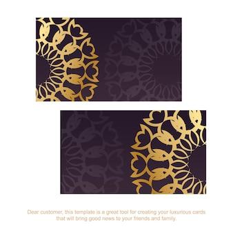 Carte de visite de couleur bordeaux avec ornements indiens en or pour votre marque.