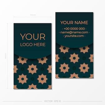 Carte de visite de couleur vert foncé avec des ornements luxueux. conception prête à imprimer d'une carte de visite présentable avec des motifs vintage.