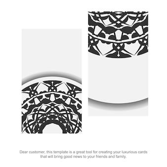 Carte de visite couleurs blanches avec ornement de mandala noir. conception de carte de visite prête à imprimer avec un espace pour votre texte et vos motifs grecs.