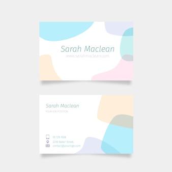 Carte de visite de coups de pinceau dans des couleurs pastel douces et des taches