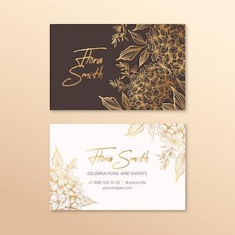 Carte de visite créative avec fleurs dorées