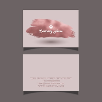 Carte de visite élégante avec un design de trait de pinceau en or rose