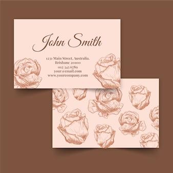 Carte de visite florale dessinée à la main de fleurs roses