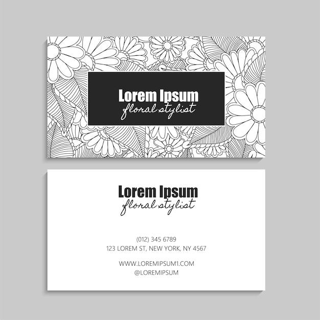 Carte de visite florale avec des fleurs noires et blanches