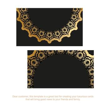Carte de visite en noir avec des ornements indiens dorés