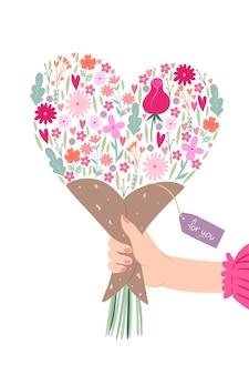 Carte de voeux avec un bouquet en forme de coeur à la main.