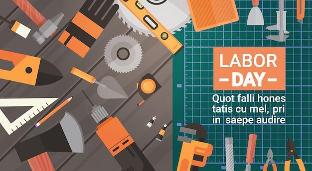 Carte de voeux fête du travail sur ensemble d'outils de travail de réparation et de construction