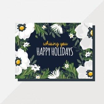 Carte de voeux avec des fleurs blanches pour noël