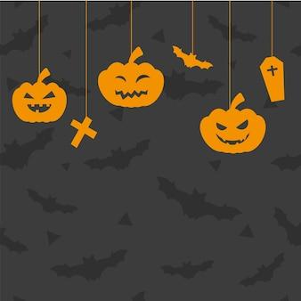 Carte de voeux halloween avec citrouilles, croix, cercueil sur une chaîne avec espace de copie. concept d'halloween