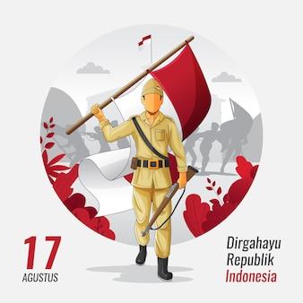 Carte de voeux d'indépendance indonésienne avec un héros portant un drapeau