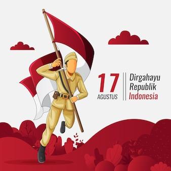 Carte de voeux d'indépendance indonésienne avec soldat portant le drapeau indonésien