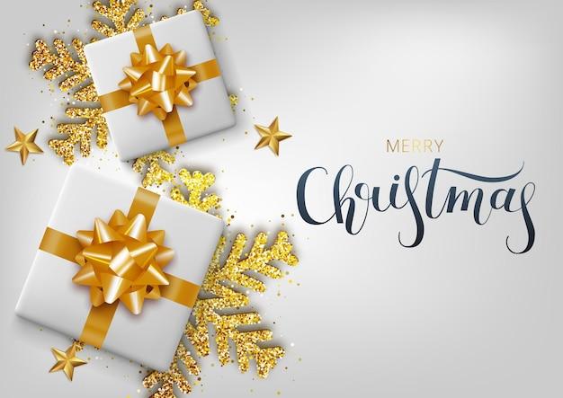 Carte de voeux, invitation avec bonne année. flocon de neige de noël en or métallique et boîte-cadeau