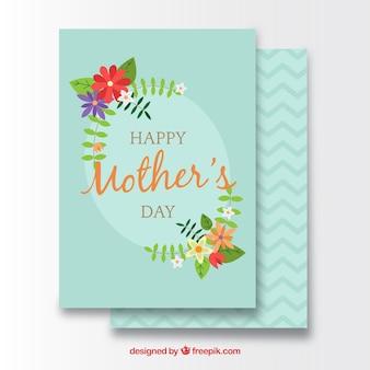Carte de voeux de jour avec des fleurs décoratives des mères