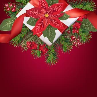 Carte de voeux joyeux noël avec boîte-cadeau et arbre de noël sur dégradé rouge, poinsetia