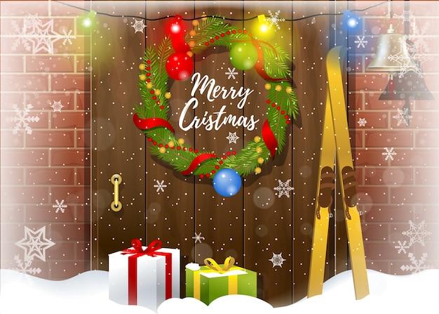 Carte de voeux joyeux noël avec des chutes de neige, des cadeaux et une couronne